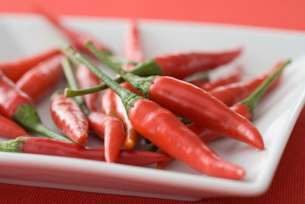 Red chilli peppers on a dish