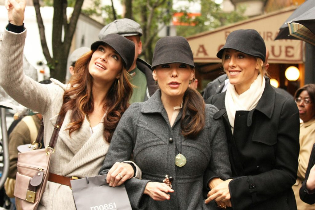 "NEW YORK CITY - NOVERMBER 06: Actresses Lindsay Price, Brooke Shields, and Kim Raver take a shopping break from filming 'Lipstick Jungle' on Madison Avenue and emerge as a threesome of sexy airline stewardesses wearing wool fedora ""elastic caps"" from the MO851 store on November 06, 2008 in New York City, New York. The women laughed and giggled their way back to set. The elastic caps retail for $95 and Brooke's cap sports a nubuck cord., Image: 27991654, License: Rights-managed, Restrictions: US MAGAZINES-PLEASE REPORT USAGE, Model Release: no, Credit line: Profimedia, Buzzfoto"