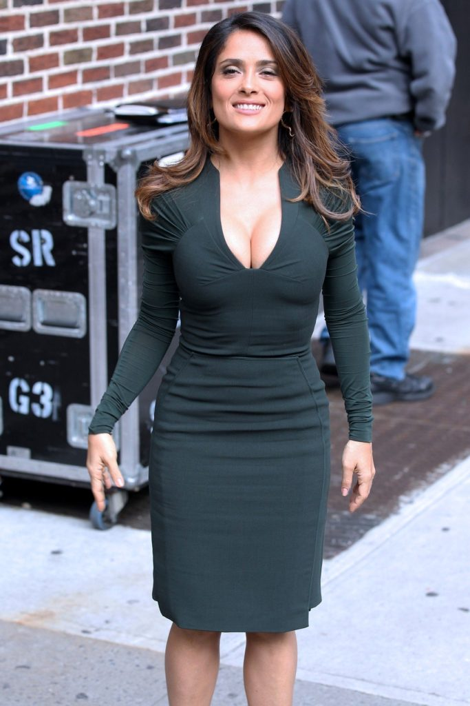 NEW YORK CITY - October 24: Mexican-American actress Salma Hayek, wearing a dark green form-fitting dress with plunging v-neck, arrives and signs autographs at The Late Show with David Letterman at the Ed Sullivan Theater on October 24, 2011 in New York, New York., Image: 105505831, License: Rights-managed, Restrictions: US MAGAZINES-PLEASE REPORT USAGE *FEE MUST BE AGREED PRIOR TO USAGE *, Model Release: no, Credit line: Profimedia, Buzzfoto
