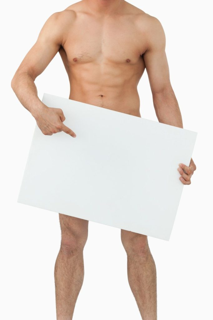 Well shaped male body pointing on banner below him against a white background, Image: 138531941, License: Royalty-free, Restrictions: , Model Release: yes, Credit line: Profimedia, Wavebreak