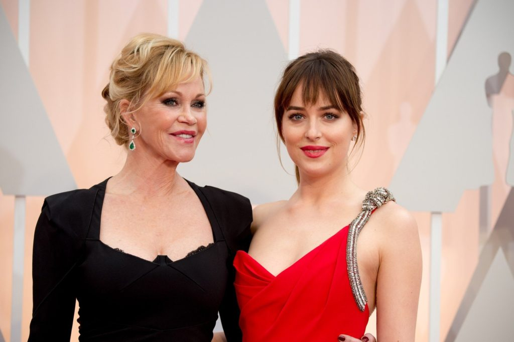 NOT FOR COVER USAGE. Actress Melanie Griffith with Oscar presenter, Dakota Johson, arrive for the live ABC Telecast of The 87th Oscars at the Dolby Theatre in Hollywood, CA on Sunday, February 22, 2015., Image: 231116782, License: Rights-managed, Restrictions: EDITORIAL USE ONLY. NO COVER USAGE. Camera Press provides this publicly distributed image for editorial purposes and is not the copyright owner. Additional permissions may be required and clearing such rights are the sole responsibility of the end user., Model Release: no, Credit line: Profimedia, TEMP Camerapress