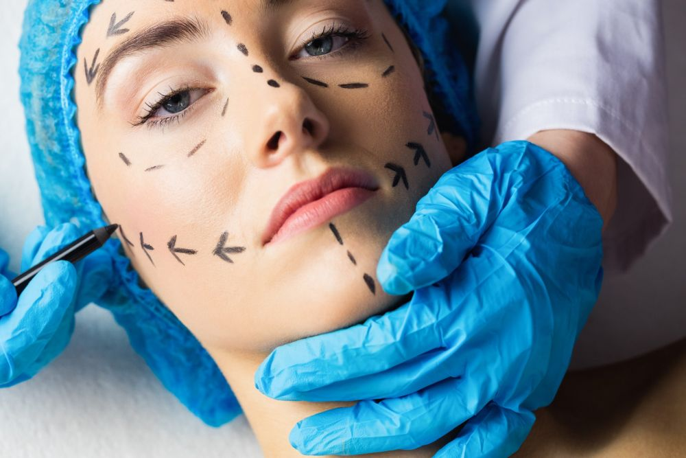 Peaceful young patient with dotted lines on the face in an examination room, Image: 290326376, License: Royalty-free, Restrictions: , Model Release: yes, Credit line: Profimedia, Wavebreak