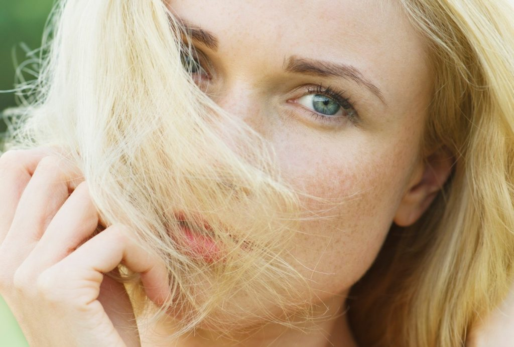 Woman covering face with hair, portrait, Image: 295623499, License: Rights-managed, Restrictions: , Model Release: no, Credit line: Profimedia, PhotoAlto