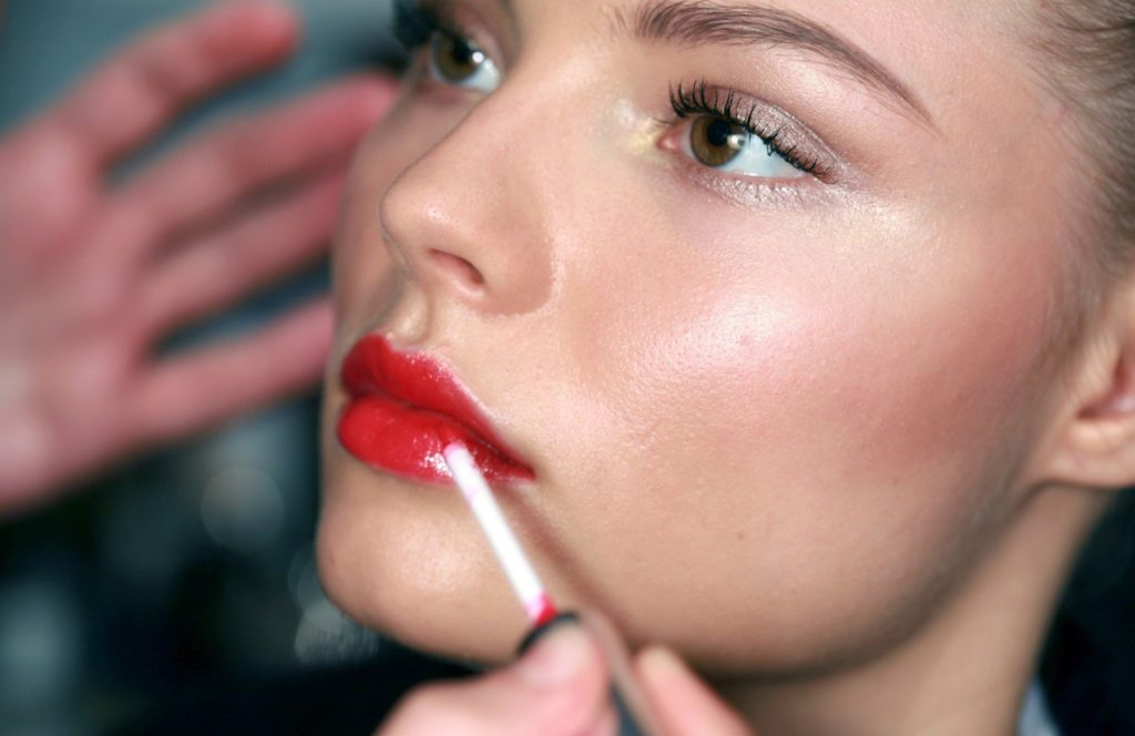 WD 1189-102 . Valentino. Backstage Paris Ready to Wear. Spring/Summer 2007. Bright red shimmering lipstick being applied on female , in semi-profile. ., Image: 221449630, License: Rights-managed, Restrictions: FOR EDITORIAL USE ONLY, Model Release: no, Credit line: Profimedia, TEMP Camerapress