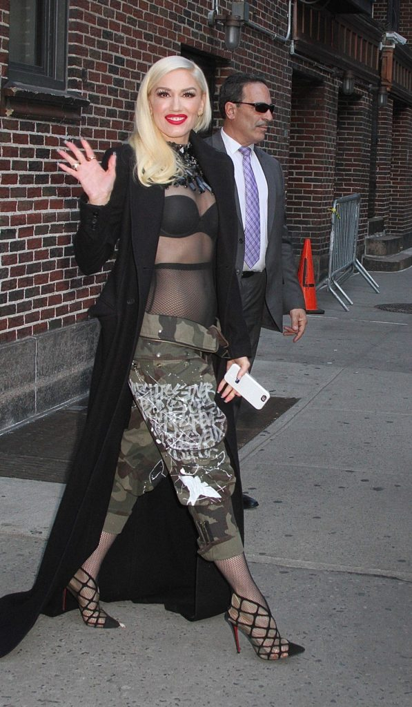 "New York, NY - Gwen Stefani can't hide her toned abs in camouflage, despite wearing camo pants, as she is seen leaving The Late Show with Stephen Colbert. The singer is seen arriving in a white dress before making a costume change into a mesh top and camo pants after performing ""Used to Love You."" April 1, 2016, Image: 280171027, License: Rights-managed, Restrictions: NO Brazil, Model Release: no, Credit line: Profimedia, AKM-GSI"